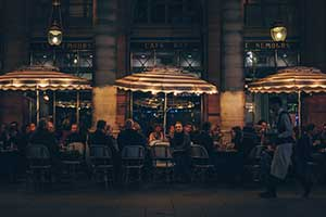 infrared heaters warm up guests sitting on the café patio